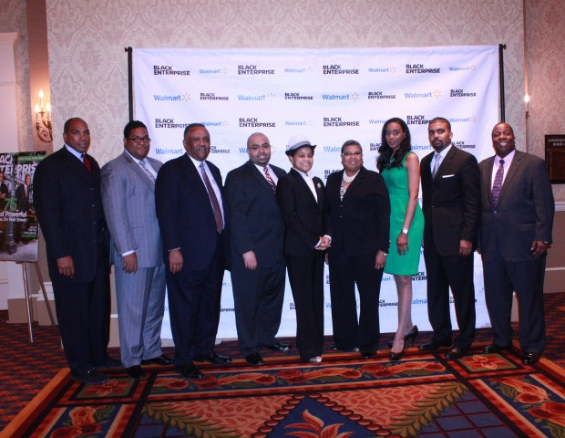 (L to R) Black Enterprise President and CEO Earl Butch Graves stands with Vision 20/20 Forum participants, Walmart representatives, and event staff. Pictured here: T. Anthony Waller, senior director of corporate affairs at Walmart; former BE 100s CEO Robert Blackwell; Black Enterprise Editorial Director, Alan Hughes; Walmart corporate affairs, Adrienne T. White; Banneker Industries CEO, Cheryl Snead; Vice President of Johnson Security Bureau, Jessica Johnson; Volt Energy co-owner, Gilbert Campbell; and Black Enterprise Editor-in-chief, Derek Dingle.