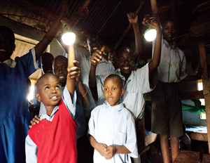 Students from Thriving Talents School in Kissi, Kenya show the power of the Nokero 200 light bulb (Image: Nokero/Cheyenne Ellis)