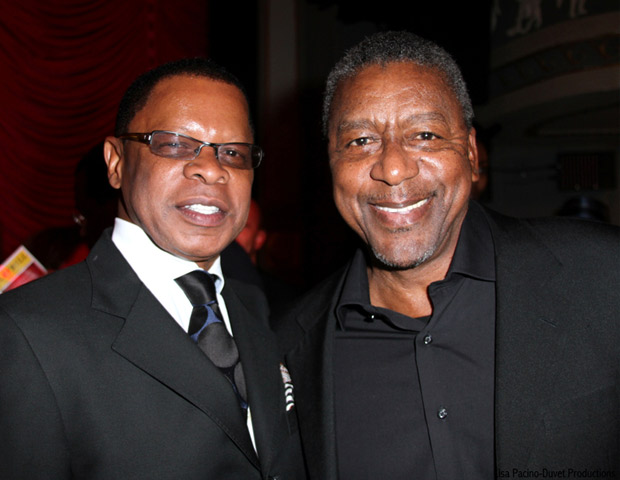 Stephen Byrd  is all smiles with media mogul Robert Johnson