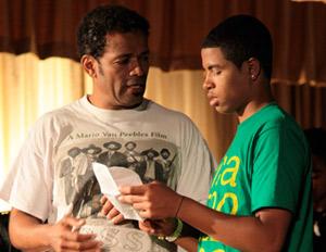 Van Peebles offers directorial advice to his son, Mandela, between takes