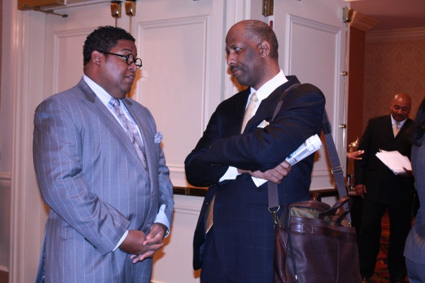 There was plenty of time to network at the Vision 20/20 Forum. Here T. Anthony Waller, senior director of corporate affairs at Walmart, talks with Matthew A. Johnson, group publisher of Girlfriends Health Guide For Everyday Women.