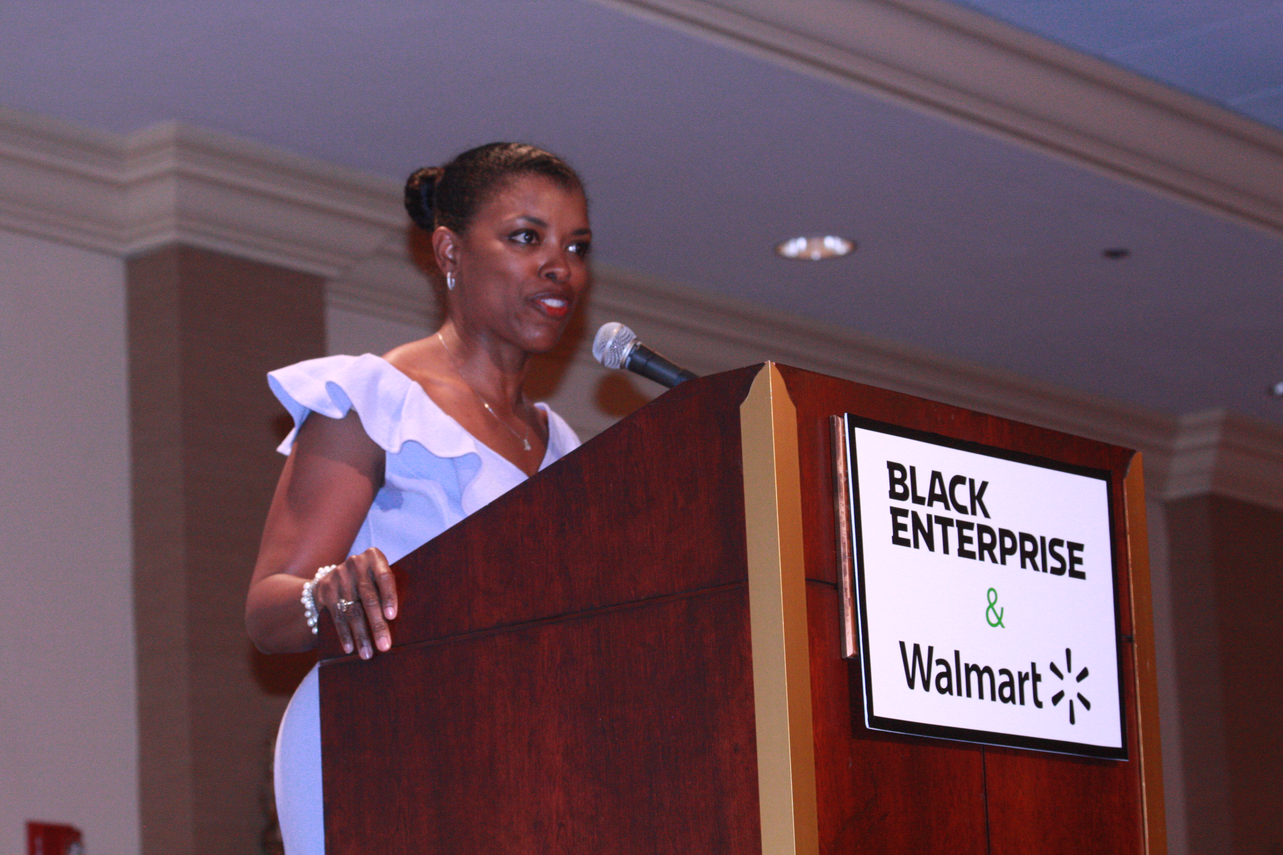 """The event began with opening remarks from Black Enterprise President and CEO, Earl """"Butch"""" Graves Jr.; Stephanie Neely, City of Chicago Treasurer (Pictured here); and Reginald Reese, Market Manager for Northern Illinois Walmart stores."""