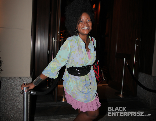 Black Blogger Month 2012 honoree Abiola Abrams of AbiolaTV shows off her spring colors and winning smile at 40/40 Club New York