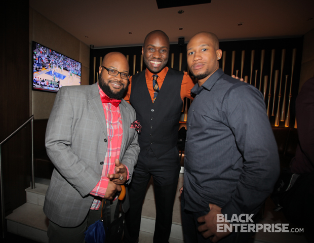 2012 Black Blogger Month honorees Christian Law of Fresher Than Chris (l) and Slim Jackson of SingleBlackMale.org (r) strike a pose with BlackEnterprise.com's Senior Producer and Black Blogger Month Editor Anslem Samuel Rocque