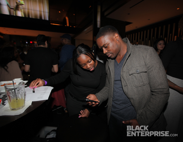 BlackEnterprise.com's Sasha King makes sure guests shared the #BlackBloggerMonth hashtag on Twitter to gain entrance to the event