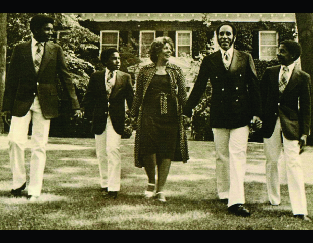 Hand-in-hand, Barbara and Earl Graves, Sr. walk with sons, Earl Jr., Michael and Johnny.