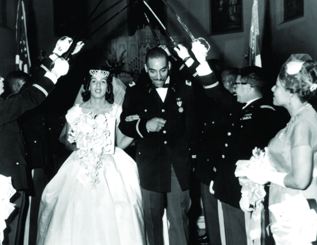 Barbara and Earl Graves, Sr. commit to a lifetime together at their wedding ceremony.