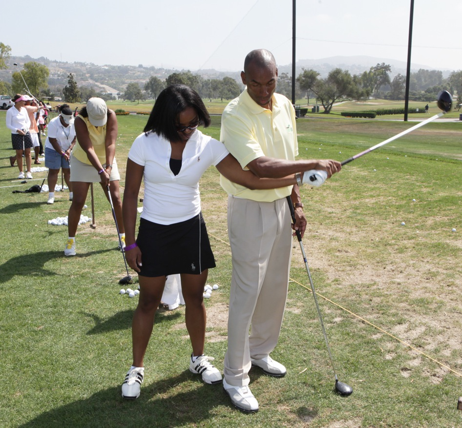 Green (right) recommends light-colored, light weight golf apparel for lessons in sunny, hot climates such as in Miami. (Image: Courtesy of Rodney Green Golf)