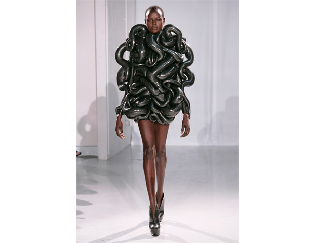 2011: Haute Couture Goes Digital      Known for fusing technology and high fashion, Dutch designer Iris van Herpen ditched traditional sewing machines altogether when she decided to create her Fall/Winter 2011 haute couture collection. Her debut in Paris featured 3D couture dresses made with rubber and metal materials. Armed with a team of architects (and Photoshop), the former intern at Alexander McQueen has since developed a line of 3-D printed shoes.