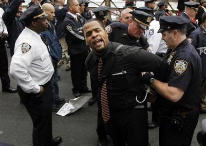 A protester reacts as he is arrested on the Brooklyn Bridge during an Occupy Wall Street protest in New York