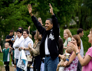 Obama cheers for his daughter Sasha's soccer team at a park in Washington, D.C.