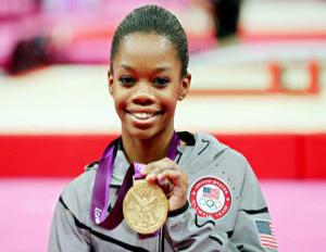 gabby douglas smiling gold medal