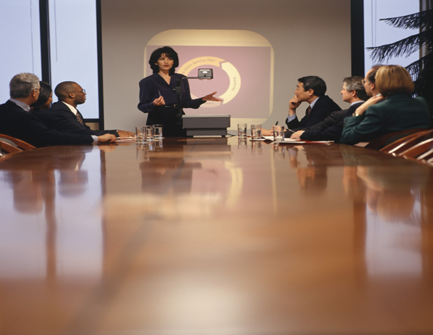 Businesswoman giving presentation in boardroom