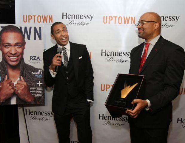 T. J.  Holmes receiving the Hennessy Privilege Award