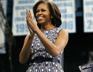 michelle obama smiling and clapping