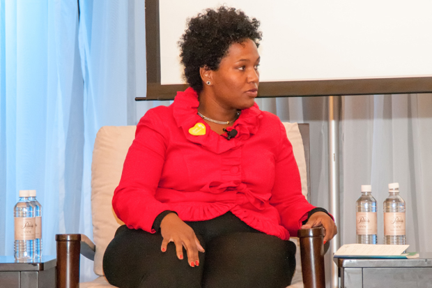 Kenya Bradshaw Executive Director, Stand for Children shares her ideas during the first panel discussion.