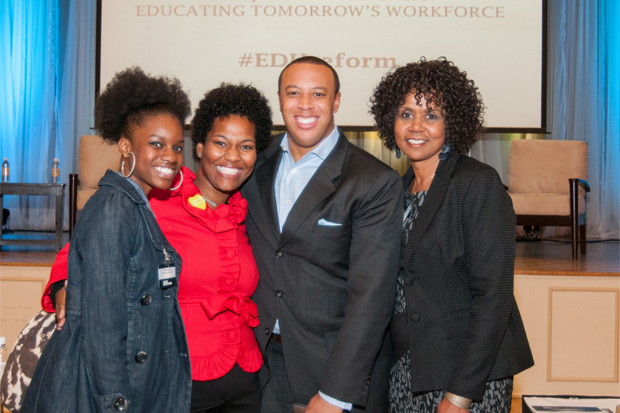 Kenya Bradshaw with attendees at the Education Reform Symposium
