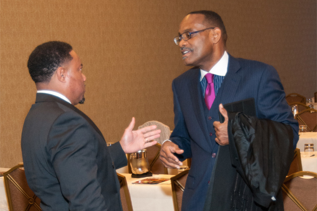 Rahim Islam, CEO of Universal Companies, networking with an attendee