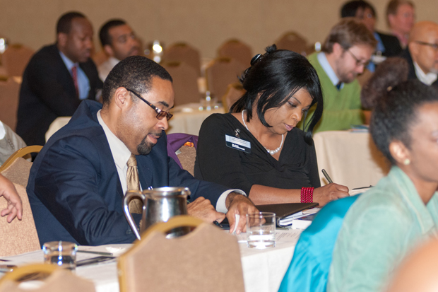 Attendees taking notes at the Education Reform Symposium in Memphis