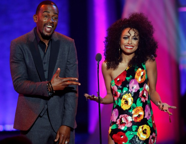 Actor/comedian Bill Bellamy and actress/model Kat Graham joke around on stage as they present an award during the Soul Train Awards.