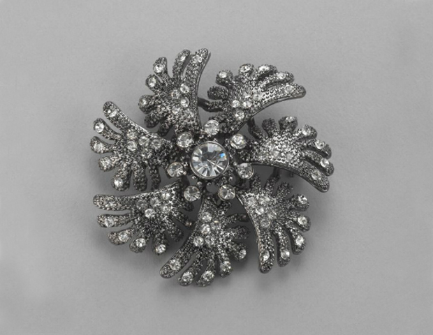 BROOCH: Nothing screams style and grace like a well-placed brooch. Instead of buttoning your sweater, wrap one side across the other and fasten it with this brooch just like the First lady would. New York & Co., $19.95