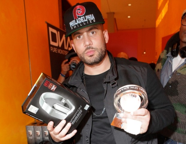 DJ Drama (National Mixtape DJ and Southeast Mixtape DJ winner) has his hands filled with his Global Spin Awards.