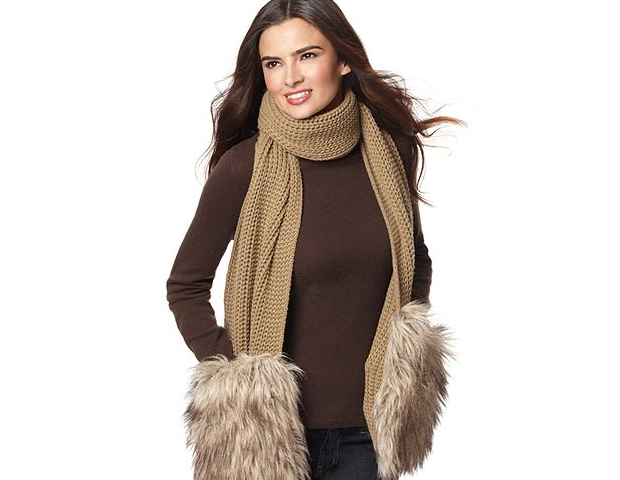 Scarf: Wear this fun and functional piece on your way into the office with it's two-in-one appeal keeping both your neck and hands warm. Macy's, $98