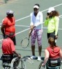 US-tennis-star-Venus-Williams-2ndR-and-her-sister-Serena-Williams-R-participate-in-a-two-hour-tennis-clinic-with-disabled-children-in-wheelchairs-at-the-Arthur-Ashe-Academy-in-Soweto-e1352035646467
