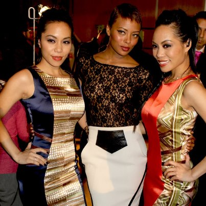 Eva Marcille flanked by the Sachika Twins, To-Tam and To-Nya.