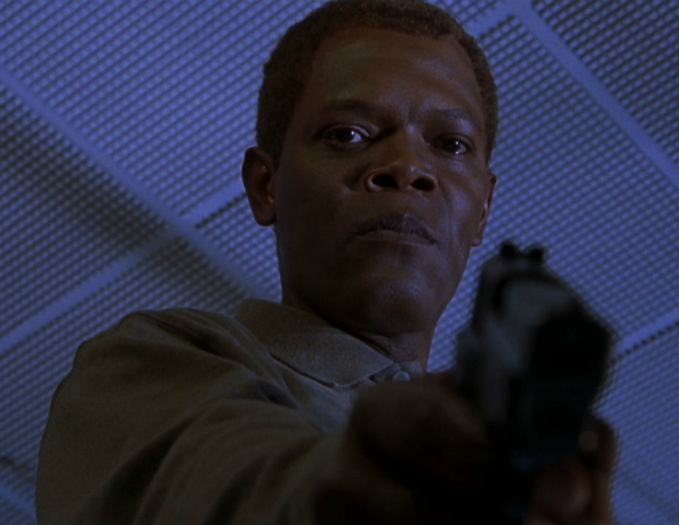 The Negotiator (1998)   Danny Roman (Samuel Jackson) is a police officer accused of killing his partner and is trying to, not only prove his innocence, but avoid being taken out by the real killers of his partner.