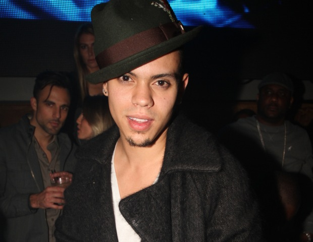 The camera finds Evan Ross alone.