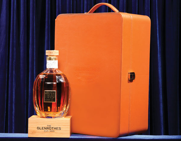 """SCOTCH WHISKY   The Glenrothes  The Glenrothes Extraordinary Cask is perfect for impressing a potential business partner, or celebrating the closing of a deal. This $5,000 special presentation of Glenrothes Single Cask with tasting notes of toffee apples, citrus, eucalyptus, and """"very, very dark chocolate,"""" is hand-signed and labeled with the distillation date July 6, 1970, in cask 10573, poured into Atlantis Crystal, and kept in a handcrafted leather carrying case with a wooded display stand and hardcover book written by noted scotch enthusiasts."""