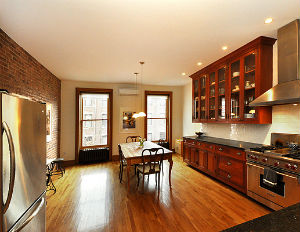 The interior of a brownstone on W. 121st St. in Harlem, which recently sold for $3 million.