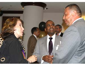 Tim Reese, founder and principal of the National Minority Angel Network, networks with members at the organization's inaugural event in May 2012.