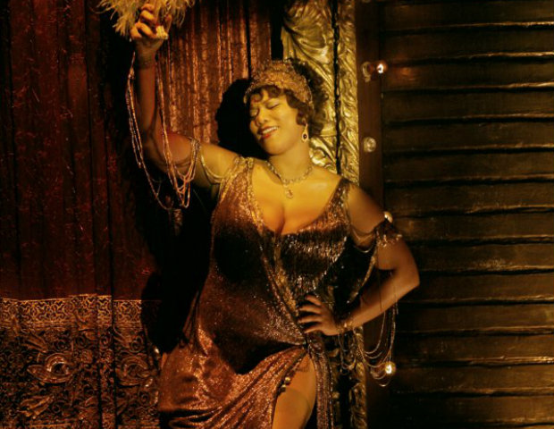 Latifah dances away as Matron Mama Morton in Chicago.