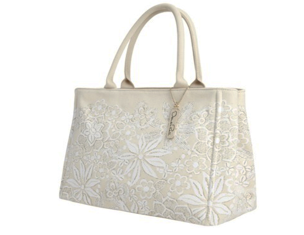 Oscar de la Renta Tote: This canvas tote bag features an irresistible silhouette with textured floral detailing. It's a fashionable look from a design legend. $59.99