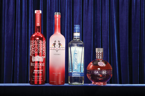 """VODKA   Belvedere (RED) Special Edition  Designed to raise awareness and money—from 50% of the profits—for HIV/AIDS in Africa, this is a rich look for any bar and an even better opportunity to pay it forward.   V Georgio Vodka  Handcrafted through a patented process that provides a smooth, rich flavor, and with two special blends offering tropical fruit accents of guarana and açaí, it is the new venture and solely owned product of African American businessman Victor G. Harvey.   New Amsterdam Vodka  It has a contemporary design, a five times distillation process for a smooth finish, and an """"outstanding"""" rating in taste awards. Try it neat. The price is special—and so is their gin, infused with juniper and other botanicals. Both are a great value.   Chambord Flavored Vodka  Offering warm, floral, and fruity accents of hibiscus flower, notes of vanilla, and white chocolate over the familiar black raspberry foundation, Chambord Flavored Vodka offers an enchanting new twist on a staple liqueur."""