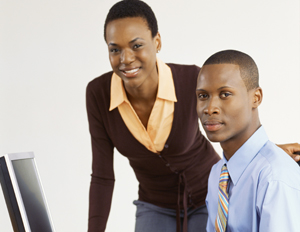 a young black man and woman in a professional setting