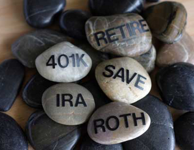 "stones that read ""IRA,"" ""401K,"" ""Roth,"" ""Retire,"" and ""Save"""