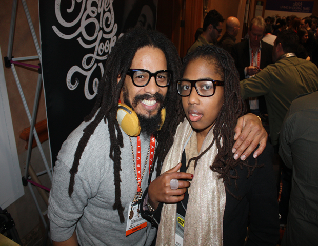 Meet Green and Healthy Living Expert Yoli Ouiya (right).  While at CES, she's trying to soak up as much information as possible about sustainable living. For her CES updates visit her site or follow her on Twitter at @yoliouiya .  Ouiya stopped to pose with House of Marley's Rohan Marley  .