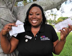 black woman wins checks money