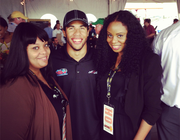 Kimberly Harris and Janell Hazelwood with race car driver Darrell Wallace Jr.