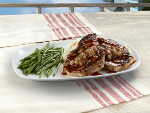 Wood-Grilled Pork Chops are just one of the new non-seafood items Red Lobster now offers in an effort to boost revenue after a recent drop. Courtesy of Darden Restaurants.