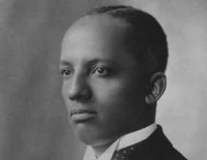 carter g woodson smiling