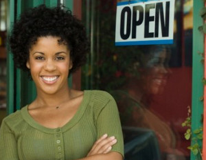 black woman smiling who owns business