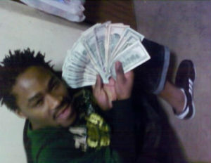 Deadbeat Dad Busted After Flaunting Wads of Cash on Facebook