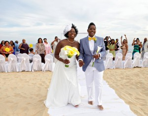 black gay couple married on beach