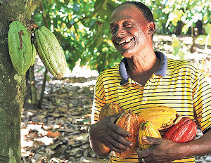 black man holding fruits