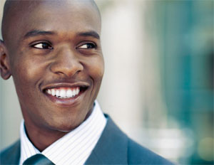 Young black employee, smiling