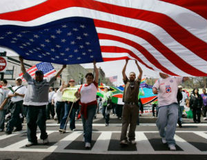 immigrants holding usa flag